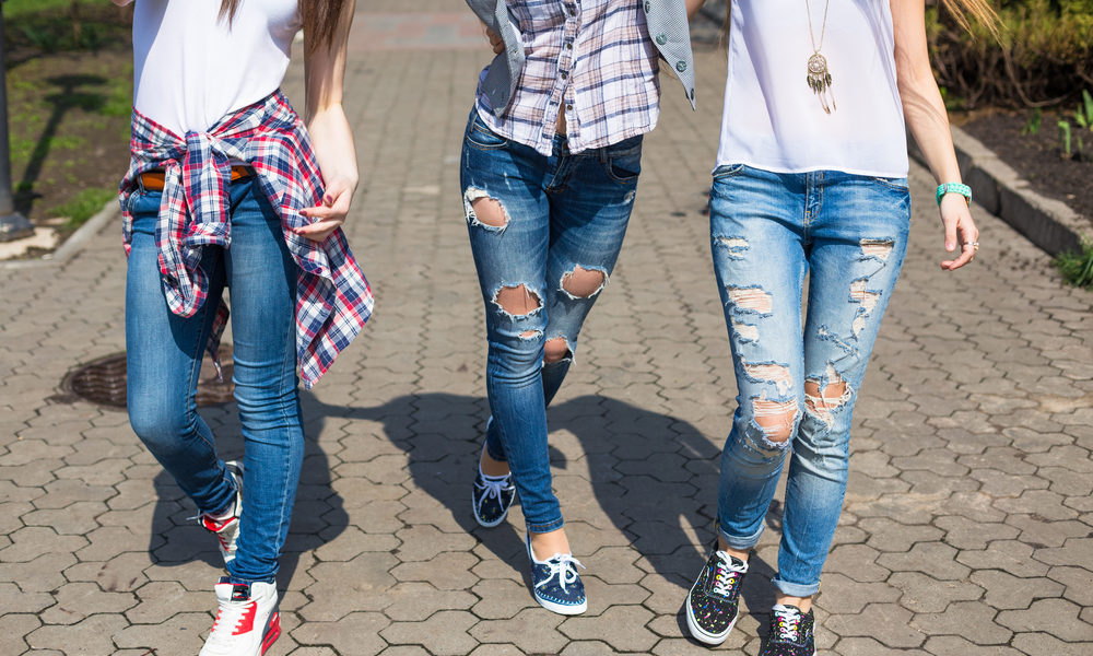 stock-photo-young-happy-hipster-teenage-girls-having-fun-in-summer-park-406768945